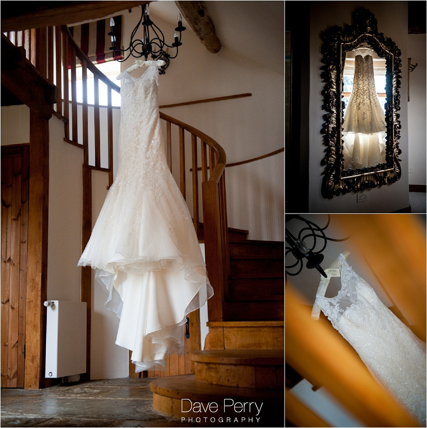 A Wedding Dress Hanging From A Chandelier At Gorcott Hall In Redditch