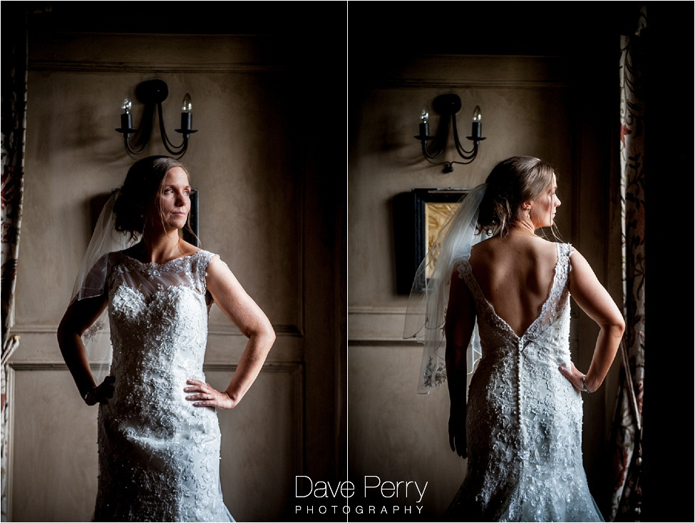 a bride casually posing at gorcott hall showing the back and front of the dress