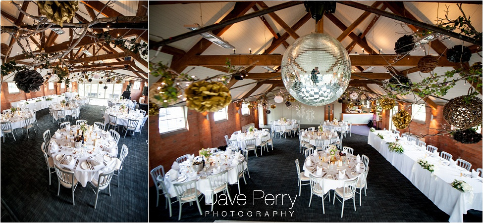 A photograph taken on a ladder of the wedding reception at gorcott hall with the disco mirror ball a prominent feature