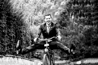 Groom having fun on a bike at Cowley manor